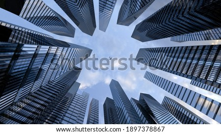 Perspective view to steel light blue of glass high rise building skyscraper city of future and airplane. Business and travel concept of industry tech architecture. 3d rendering. 3d illustration Stockfoto ©