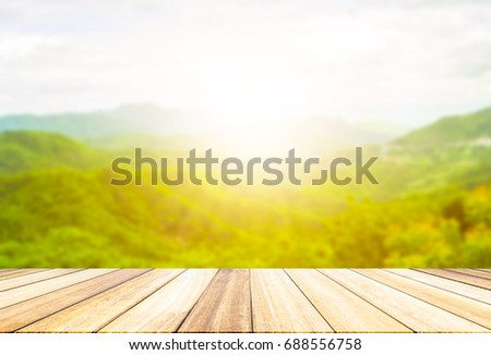 Perspective wood deck overlook the mountains  background atmosphere as the sun sets. Services include product display  template #688556758