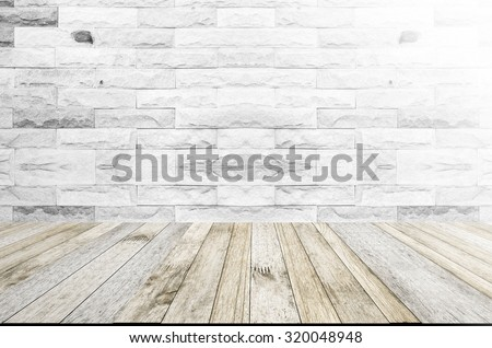perspective wood plank floor or walk way with Brick wall white color background with light flare for art interiors design in home, house, building, shop, store, art store, coffee shop