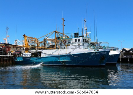 PERTH, AUSTRALIA - 26 DECEMBER 2016: A fishing trawler moored in Fremantle Harbour. Fremantle is Western Australia's largest & busiest general cargo port & an important historical site. Editorial. #566047054