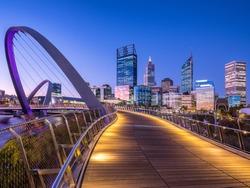 Perth CBD skyline at sunset viewed from the pedestrian bridge at Elizabeth Quay