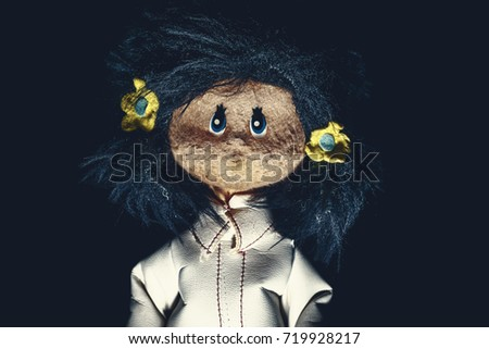 Shutterstock Perturbing vintage rag doll with long dark hair and white coat. Original photo of ancient toy (copyright free) retouched and colored, neither artworks, layers nor external references were used