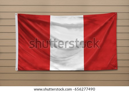 Peru Flag hanging on a wall #656277490