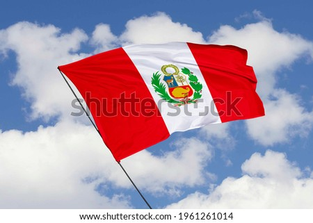 Peru flag isolated on sky background with clipping path. close up waving flag of Peru. flag symbols of Peru.