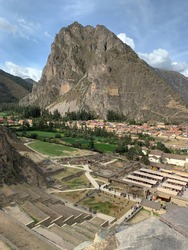Peru Ollantaytambo Ollanta town of buildings built on foundations of Inca stonework in Sacred Valley Cuzco region Andes mountains.  Pinkulluna Inca storehouses. Ancient Incas fortress ruins.