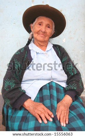 PERU - SEPTEMBER 25: Portrait of an old indigenous woman in traditional clothes sitting in front of a house. Great trekking adventure September 25, 2005 in Peru.