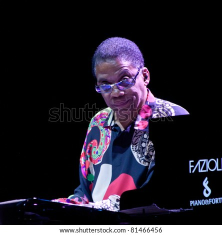 PERUGIA, ITALY - JULY 9 : Herbie Hancock  plays piano and keyboards on main stage at Umbria Jazz Festival - July 9, 2011 in Perugia, Italy