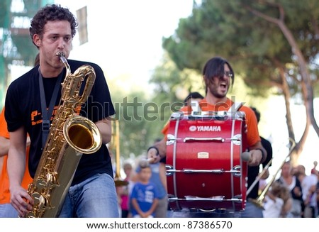 """PERUGIA, ITALY - JULY 29: The street big band called """"P-Funking"""" play music during the """"Trasimeno Blues Festival"""" on July 29, 2011 in Perugia (Italy)"""