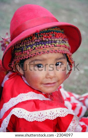 Peruvian child in traditional dress stock photo