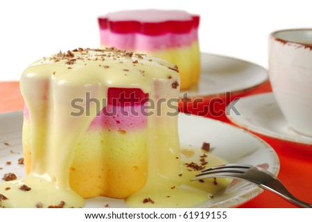 "Peruvian colorful small cakes called ""Torta helada"" in the shape of a flower with vanilla custard, chocolate shavings and coffee (Selective Focus)"