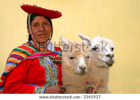 Peruvian lady in authentic dress with two lamas in Cusco, Peru.