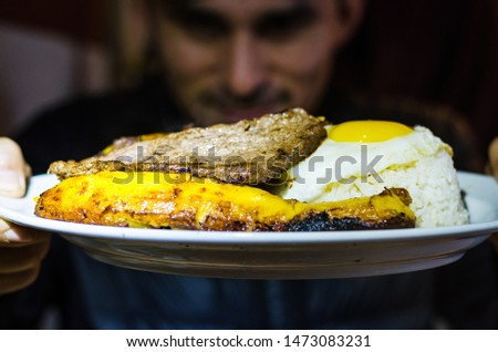 Peruvian Latin American food. Bistec a lo pobre. Beef tenderloin with french fries, fried plantain, rice and eggs. Top view Foto stock ©