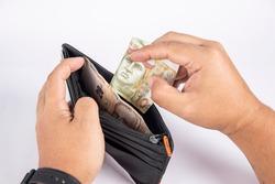 Peruvian money from wallet. Dinero peruano saliendo de billetera.