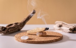 Peruvian palo santo holy wood smoke. Esoteric objects for meditation, antistress and relaxation purifying concept. Smudge kit for spiritual practices.