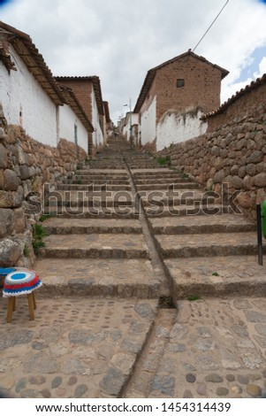 Peruvian streets.  Chinchero Peru. to include the drainage that ran down the middle of the street.