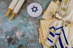 Pesach Passover celebrating symbols of great Jewish family holiday traditional matzah, kippah and tallit, torah scroll