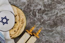 Pesah celebration Jewish traditional holiday with torah scroll and kosher matzah on passover day