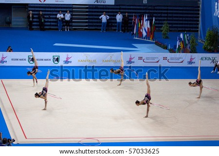 PESARO, ITALY - MAY 2 : Italian Team, competes in team exercise with 5 hoops at Rhythmic Gymnastic World Cup 2009 on May 2, 2009 in Pesaro, Italy