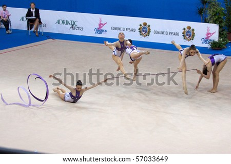 PESARO, ITALY - MAY 2: Italian Team, competes in team exercise with 5 hoops at Rhythmic Gymnastic World Cup 2009 on May 2, 2009 in Pesaro, Italy
