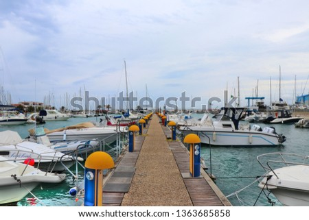 Pescara, Italy. April 2019. View of the Pescara tourist port with sail boats and yachts anchored. In the background, the Adriatic sea. #1363685858