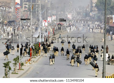 PESHAWAR, PAKISTAN, SEP 21: Residents of Peshawar are protesting at G.T Road near KPK Assembly during demonstration against blasphemy anti-Islami movie released  on September 21, 2012 in Peshawar.