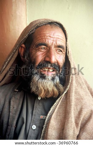 PESHAWAR, PAKISTAN - SEPT 10: An unidentified man poses for a portrait as he rests after hard work September 10, 2007 in Peshawar, Pakistan.