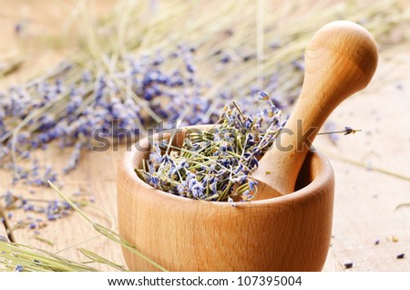 Pestle and mortar with lavender on the oak table