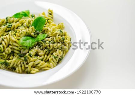 Pesto and pine nut pasta salad, fusilli pasta with regato cheese and baby spinach coated in basil pesto, Italian food Zdjęcia stock ©