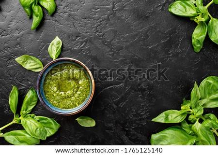 Pesto. Italian basil pesto sauce on black background. Flat lay Zdjęcia stock ©
