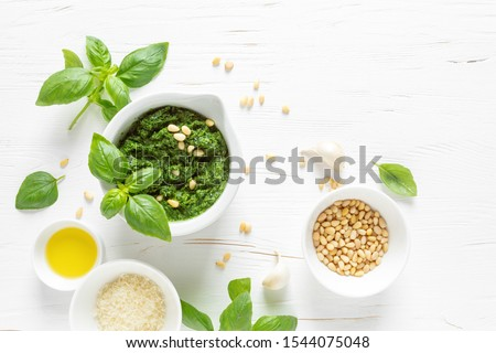 Pesto. Italian basil pesto sauce with culinary ingredients for cooking