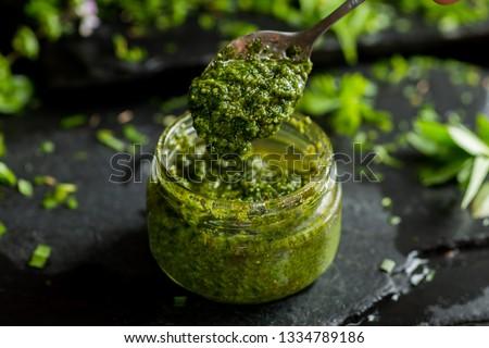 pesto sauce in a spoon, jar with pesto sauce Zdjęcia stock ©