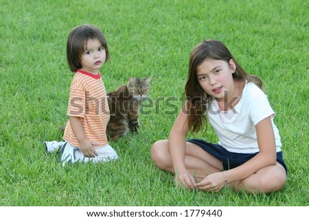 Pet and Kids Sitting in the Grass - Family Life