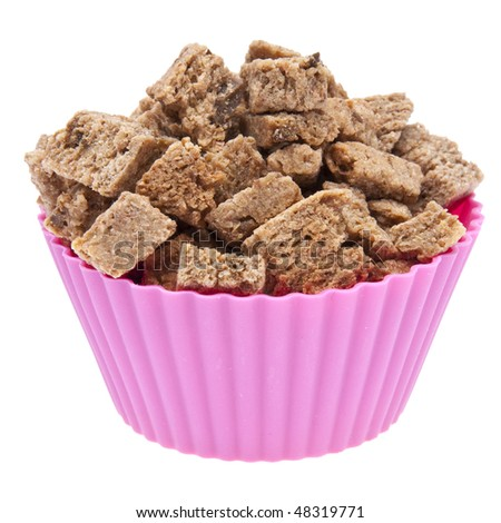 Pet Treats in a Vibrant Cupcake Wrapper.  Isolated on White with a Clipping Path.