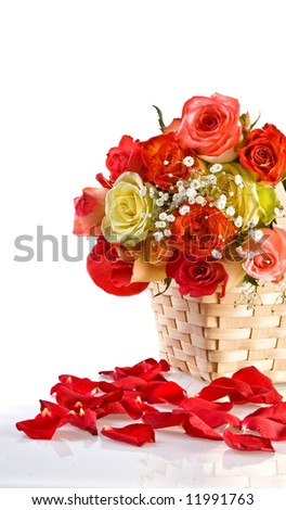 Petals and multicolored roses in a basket