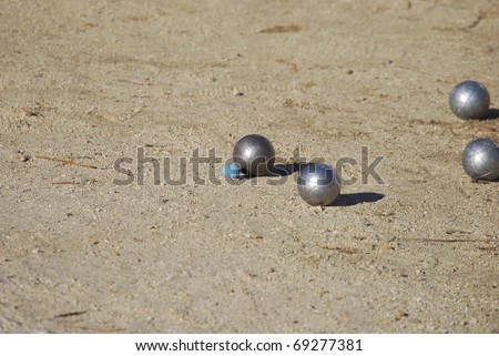 Petanque balls on the ground. Fun and relaxing game