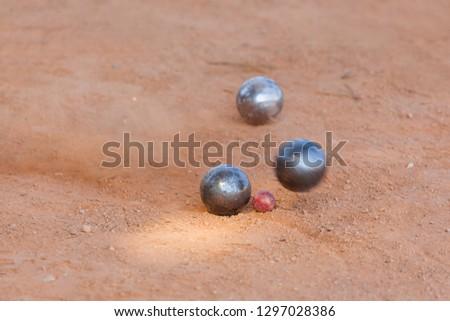 Petanque balls on the ground - sport background