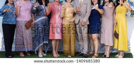 Petchburi Thailand,May 25, 2019: The people are show I love you body language sign with smile on the face in the wedding ceremony, in concept of happy and joyful. #1409685380