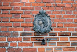 Peter the Great old bronze bas-relief on the brick wall of the Cathedral, Kaliningrad, Russia