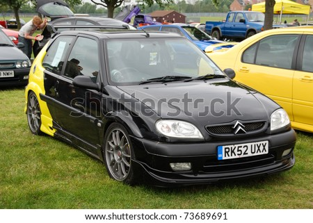 Citroen Saxo Black. and Yellow Citroen Saxo on