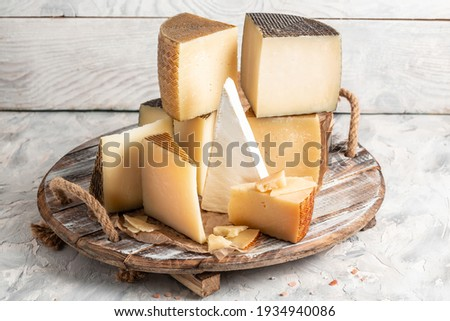 Petit Basque, French cheese, Cheese board of various types of soft and hard cheese. spanish manchego cheese.