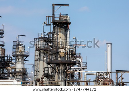 Petro chemical refinery pipes and cracking towers against a blue sky stock photo