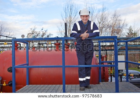 Petrochemical contractor posing in front of an oil refinery. Outdoor