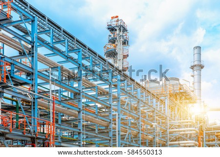 Petrochemical oil refinery, Refinery oil and gas industry, The equipment of oil refining, Close-up of Pipelines and petrochemical industrial plant towers view of oil and gas refinery