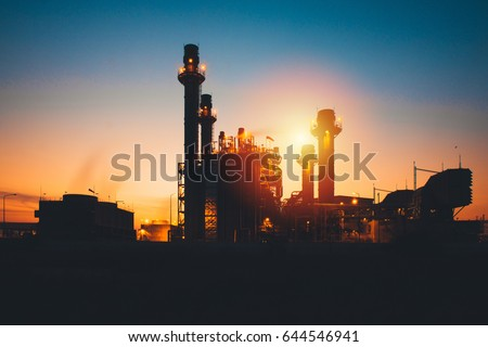 Petrochemical plant in silhouette image at sunset,Glow light of petrochemical industry on sunset and Twilight sky ,Power plant,Energy power station area
