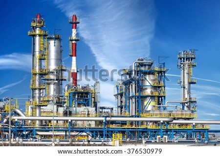 Petrochemical plant, oil refinery factory over blue sky. #376530979