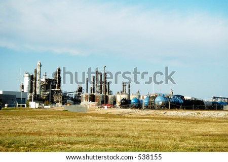 Petrochemical refinery and tank cars.