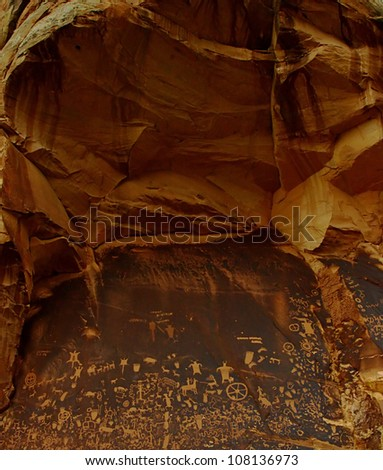 Petroglyphs on Newspaper Rock near Canyonlands National Park, south of Moab, southeastern Utah, USA. The petroglyphs shows a mixture of human, animal, material and abstract forms.