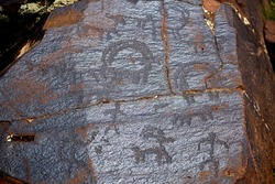 Petroglyphs on the rocks in Kazakhstan. The ancient parking cave man. Historical cave paintings. Carved on stone images of deer, goats and wolves. The development of ancient peoples.