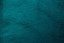 Petrol colored wall texture background with textures of different shades of teal