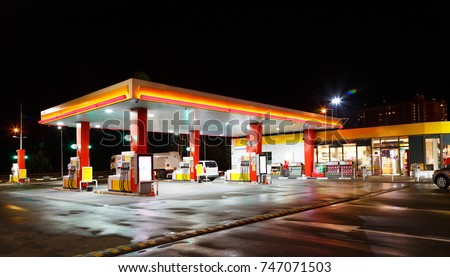 Petrol gas station station at night with lights on and mini-mart  #747071503